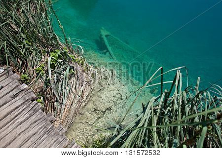 Submerged boat in lake in the Plitvice national park