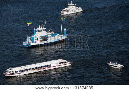 SWEDEN, STOCKHOLM - JUNE 05, 2011: Touristic ferries, sightseeing ships and boats in Strommen strait in Saltsjon bay in Stockholm