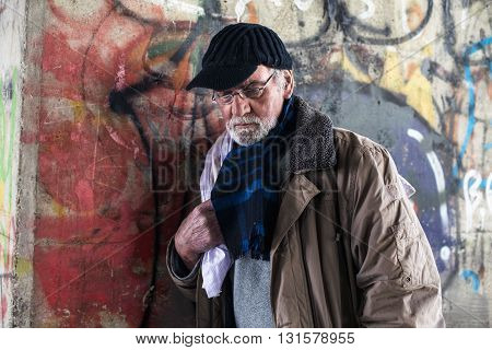 Homeless Man Against Concrete Pillar Under Bridge.