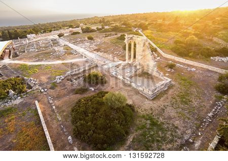 Aerial view of the arcaeological site of Apollon Ilatis sanctuary in Limassol Cyprus. The ruins of the ancient Greek temple of god Apollonas Ylatis in the old kingdom of Kourion in the woods. poster