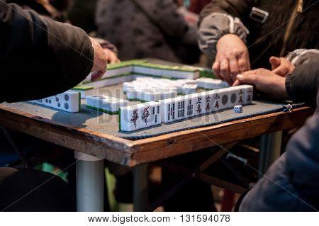 People playing Mahjong in Congjiang Guizhou China