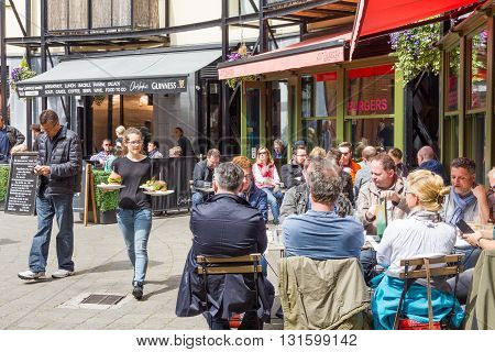 DUBLIN, IRELAND - 05 MAY, 2016: People drinking in a restaurant by the Guinness Storehouse. The place is one of the most visited Irish sites and contains many attractions distributed in seven floors.