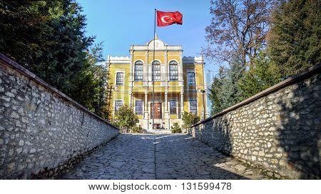 Safranbolu, Turkey - January 20, 2013: Safranbolu Government Office building (Safranbolu Hukumet Konak) with Turkish flag