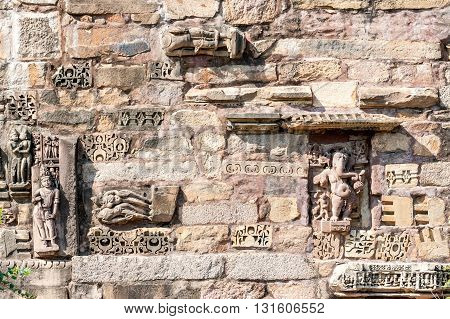 Ancient restored wall with bas-reliefs in Khajuraho temples India.