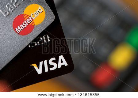 Bangkok Thailand - May 24 2016: Closeup of VISA credit cards on the credit card machine.