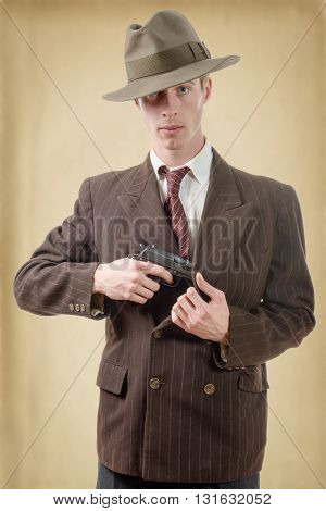 a gangster in a suit vintage with handgun poster