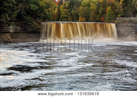 Tahquemenon Falls is a popular travel destination in the Upper Peninsula of Michigan. Sometimes referred to as the rootbeer falls because of the tannins that leach from the surrounding cedar forest and into the river water.