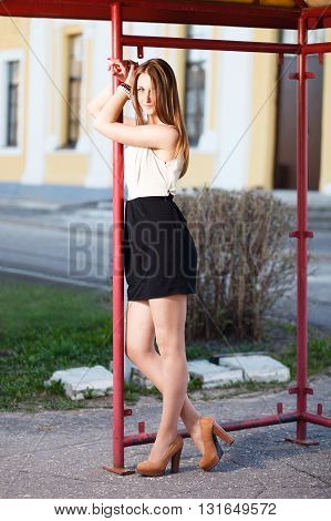 Caucasian girl waiting at old bus stop.