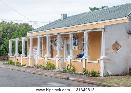 MIDDELBURG SOUTH AFRICA - MARCH 8 2016: A childrens home in Middelburg in the Eastern Cape Karoo Region. Workers are painting the building