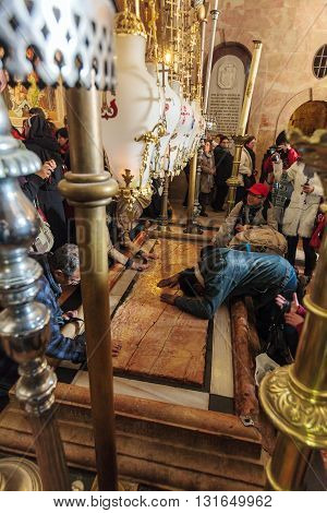 Jerusalem, Israel - February 16, 2013: Pilgrims Praying Near Stone Of Unction In Church Of The Holy