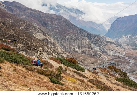 Female trekker enjoying a mountain panorama. Annapurna region in Nepal.