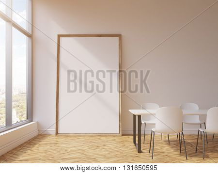 Blank picture frame leaning on concrete wall in conference room interior with wooden floor and window with city view. Mock up 3D Rendering