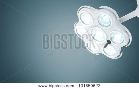 Turned on medical lamp on gray background. Mock up 3D Rendering