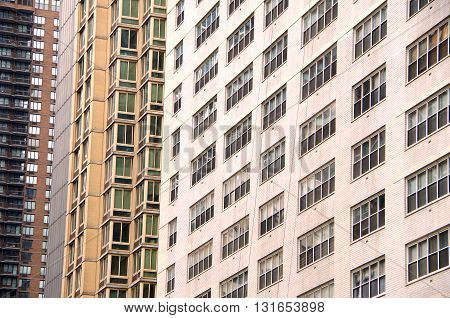 NYC high rise apartment building windows background