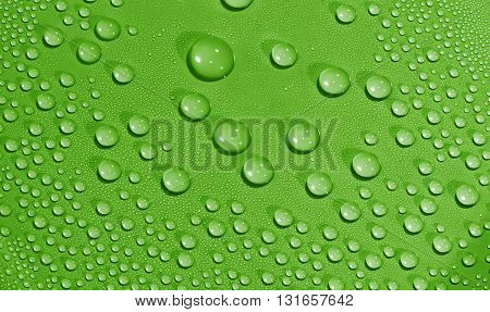 Water drops background. Texture of water drops. Green.