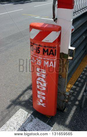 Monte-Carlo Monaco - April 28 2016: Red and White Monaco Grand Prix Historique Plastic Signboard in Monte-Carlo Monaco