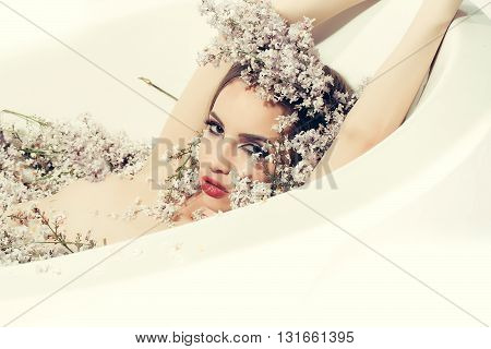 Girl Enjoys Bath With Lilac