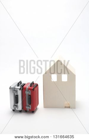 House and suitcases on white background. Vacation rentals, renting private homes and rooms.