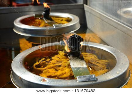 Burning candles in temple, One candle is lit on each day of the week-long celebration