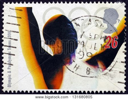 GREAT BRITAIN - CIRCA 1996: a stamp printed in the Great Britain shows Victorious Athlete 1996 Summer Paralympic Games Atlanta circa 1996