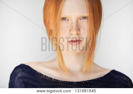 Headshot Of Teenage Girl With Red Hair, Blue Eyes And Smooth Fresh Clean Skin, Looking At The Camera