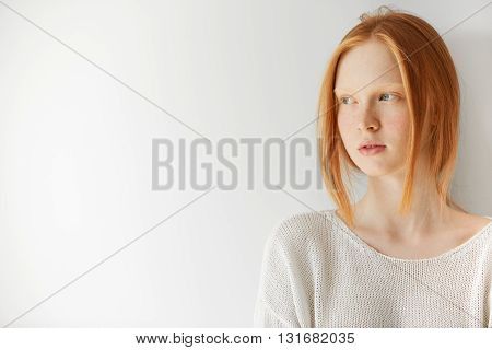 Isolated Headshot Of Pretty Teenage Girl With Ginger Hair And Perfect Freckled Skin Holding Arms Fol