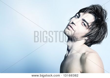 Portrait of a handsome muscular young man. Shot in a studio. poster