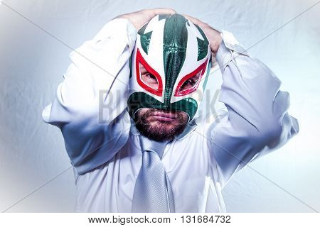 Frustrated, angry businessman with Mexican wrestler mask, expressions of anger and rage poster
