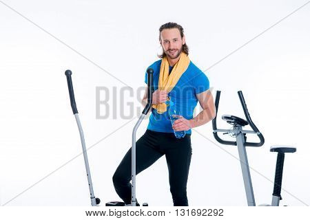 Man Train With Fitness Machine And Drinking Water
