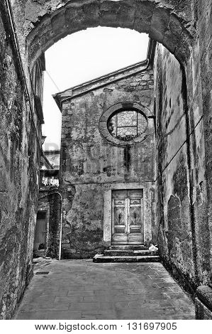 Narrow Alley with Arch in Italian City of Sorano Retro Image Filtered Style
