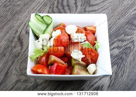 Salad With Mozzarella, Tomato And Cucumber