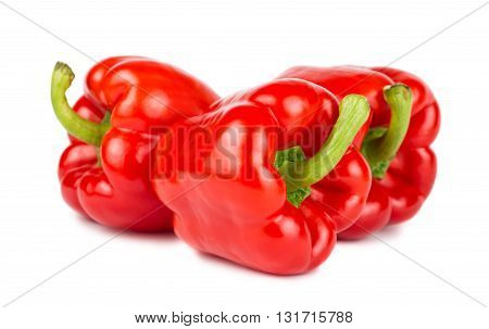 Three red ripe sweet peppers on white background