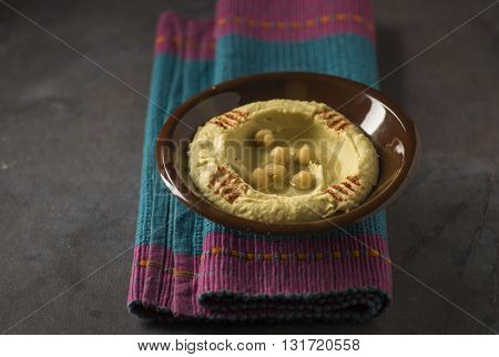 Bowl of Hummus - a popular arabic dip made with chickpeas paste. Hummus - Middle Eastern cuisine.