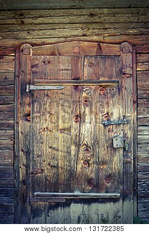 wooden door on old traditional house in Transylvania Romania textural image