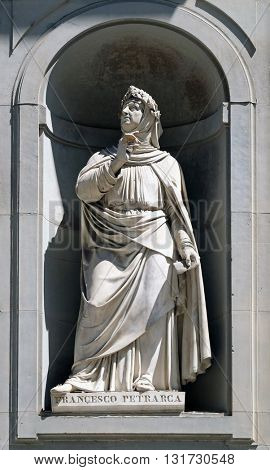 FLORENCE, ITALY - JUNE 05: Francesco Petrarca in the Niches of the Uffizi Colonnade. The first half of the 19th Century they were occupied by 28 statues of famous people in Florence, on June 05, 2015