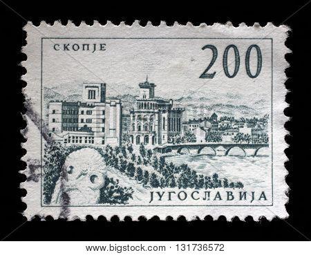 ZAGREB, CROATIA - JUNE 14: Stamp printed in Yugoslavia shows a Bridge at Skopje, with inscription