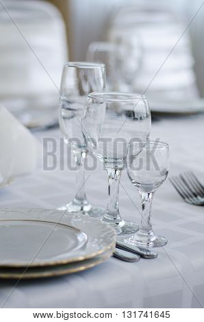Wedding decorated table. Luxury light decor on table in restaurant