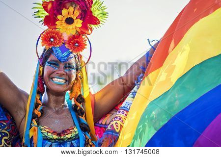 Rio de Janeiro, Brazil - February 9, 2016: Beautiful Brazilian woman of African descent wearing colourful costume and smiling during Carnaval 2016 street parade in Rio de Janeiro, Brazil.