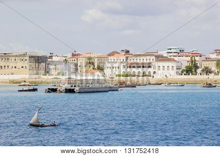 Small Vessel Sailing Along The Coast Of Zanzibar