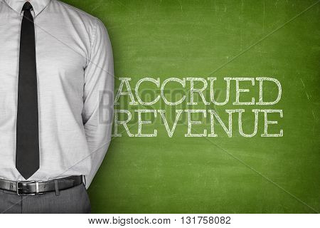 Accounting concept on blackboard with businessman standing side