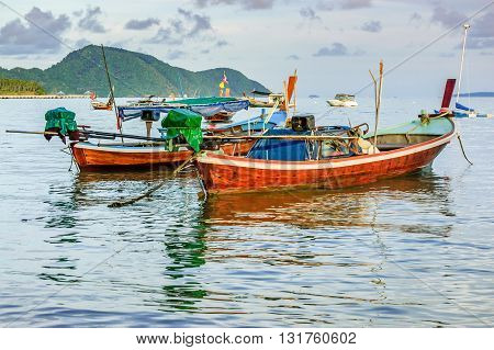 Long-tail boats at anchor in Phuket southern Thailand