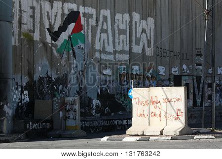 BETHLEHEM, ISRAEL, 2 APRIL 2013. Editorial photograph of Illegally Occupied Land Graffiti By Separation Wall. Photograph taken at the north end of Manger Street in Bethlehem.