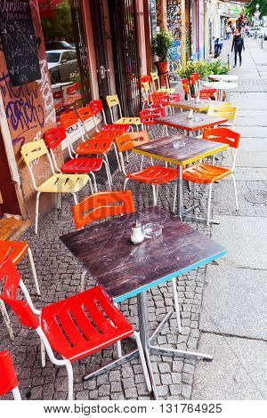 Berlin Germany - May 17 2016: street cafe in Berlins district Kreuzberg with unidentified people. Kreuzberg has emerged from one of the poorest quarters to one of Berlins cultural centers