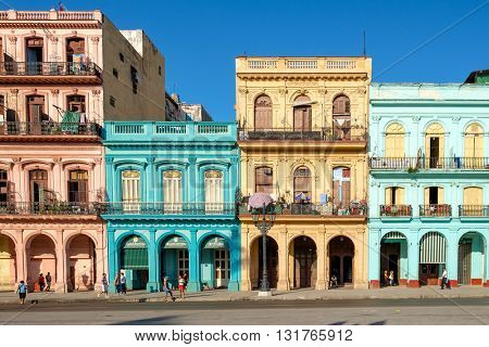HAVANA,CUBA - MAY 26,2016 : Street scene with old cars and colorful buildings in downtown Havana