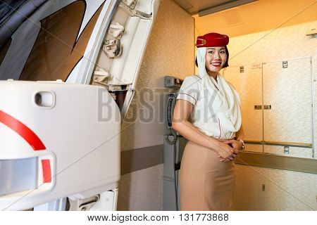 DUBAI, UAE - CIRCA MAY, 2016: Emirates crew member meet passengers on board of Boeing 777. Emirates is one of two flag carriers of the UAE along with Etihad Airways and is based in Dubai.