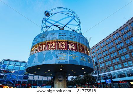 Berlin Germany - May 16 2016: Urania World Time Clock on Alexanderplatz. It is a 10 meters high clock installation with names of 148 cities on the metal rotunda erected 1969.