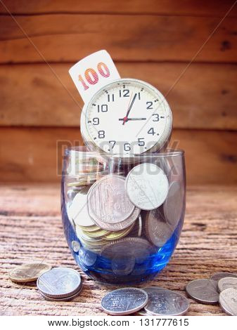 concept idea many coin in blue glass with timeidea for business save time and save money