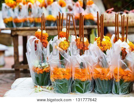 Marigold flower with joss for Buddha warship