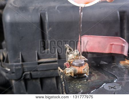 Car battery corrosion on terminal,Dirty battery terminals ,Cleaning battery terminals by hot water. poster