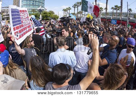 SAN DIEGO USA - MAY 27 2016: Media cameras frantically capture the action as anti-Trump protesters meet Trump supporters outside a Donald Trump rally at the San Diego Convention Center.
